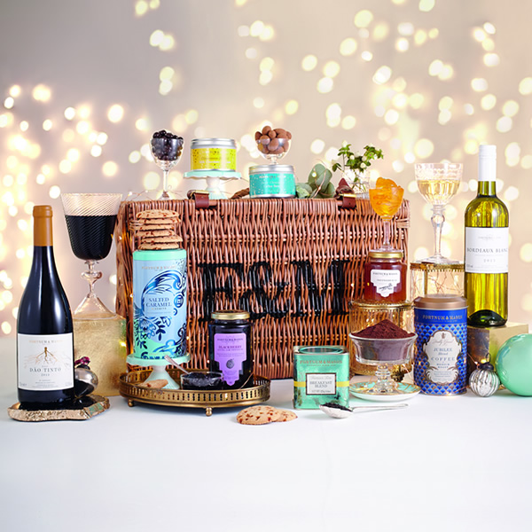 The Grosvenor Hamper comes beautifully presented in a traditional wicker, packed to please even the most discerning palate. It's filled to bursting with an impressive feast for Christmas.